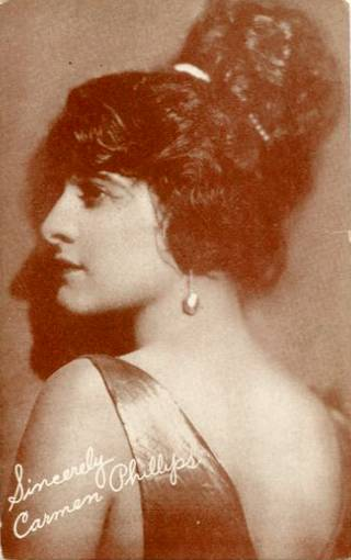 - arcade-card-exhibit-supply-company-movie-star-carmen-phillips-profile-with-hair-up-and-large-pearl-earring-1920s