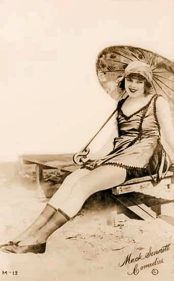 arcade-card-mack-sennett-comedies-woman-on-beach-bench-with-parasol