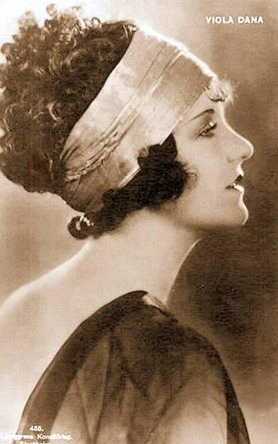 arcade-card-movie-star-viola-dana-profile-in-large-satin-head-band-and-filmy-dress