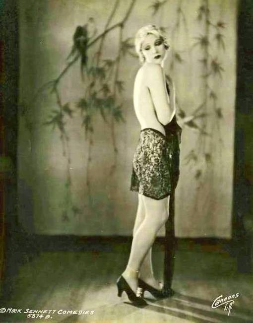 photo-for-arcade-card-mack-sennett-comedies-movie-star-marion-mcdonald-profile-with-lace-drape-bare-back-head-toward-camera-1920s
