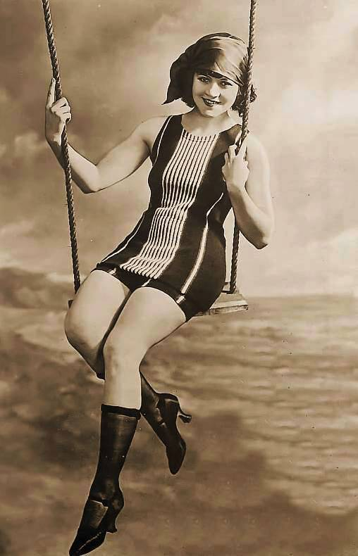 photo-for-arcade-card-movie-star-marie-prevost-on-swing-in-bathing-suit-in-studio-1920s