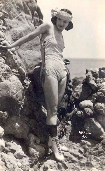 photo-for-arcade-card-movie-star-myrtle-reeves-standing-by-rocks-in-head-band-1920s