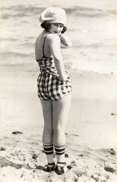 photo-for-arcade-card-movie-star-vera-steadman-on-beach-back-to-camera-in-checked-bathing-suit-and-wool-cap