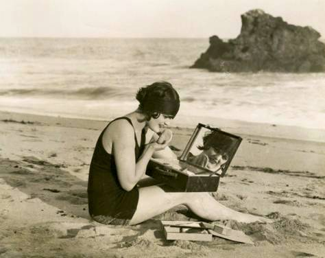 photo-for-arcade-card-movie-star-vera-steadman-profile-sitting-on-beach-touching-up-make-up-wonderful-image