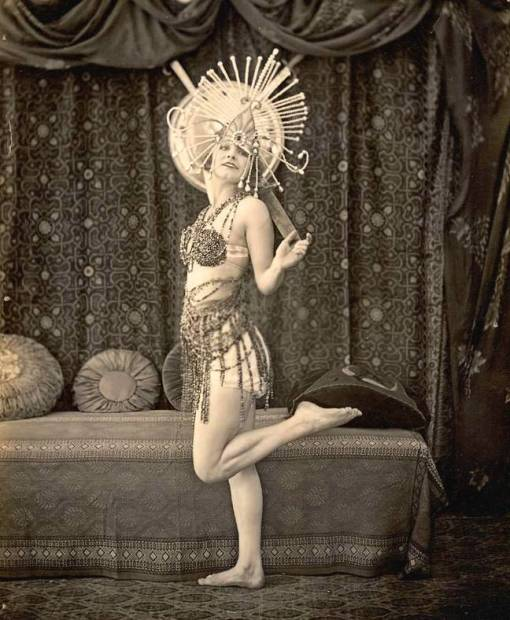 photo-for-arcade-card-woman-in-aztec-like-head-dress-in-dance-pose-sepia-1920s