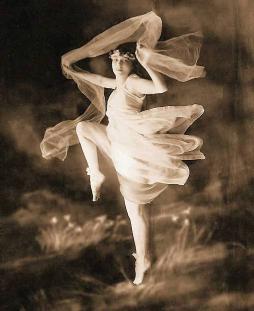 photo-for-arcade-card-woman-in-sheer-dress-holding-veil-dancing-sepia-1920s