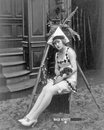 photo-mack-sennett-comedies-movie-star-marvel-rea-sitting-on-box-by-camera-tripod-with-puppy