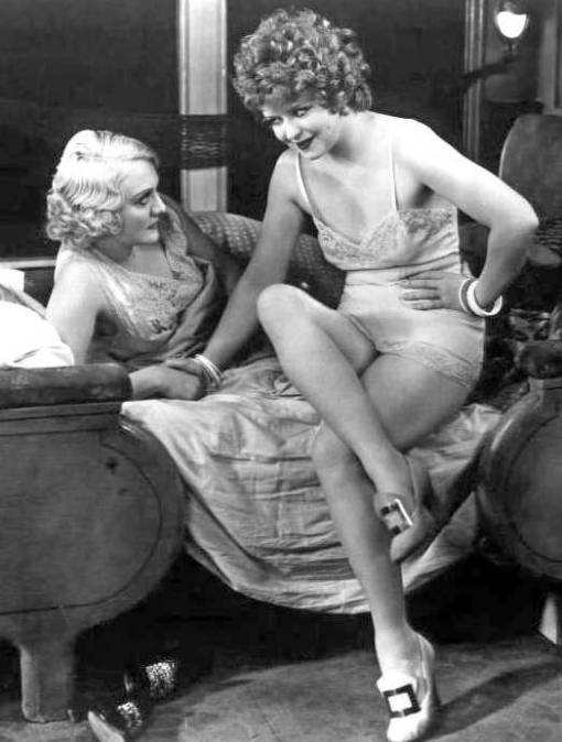photo-movie-star-clara-bow-in-brief-slip-stting-on-bed-talking-to-another-woman-still-from-movie