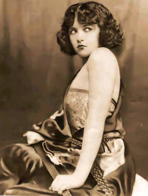 photo-movie-star-marie-prevost-sitting-profile-head-turned-towards-camera-1920s