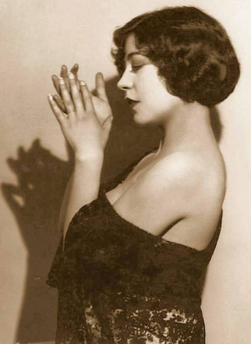 photo-movie-star-renee-adoree-profile-in-lace-wrap-hands-posed-in-front-of-face-1920s
