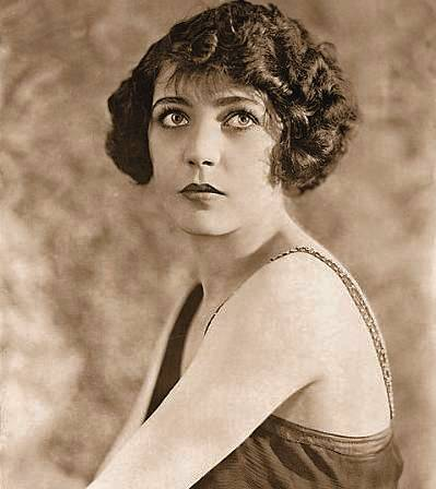 photo-movie-star-renee-adoree-shoulders-profile-and-full-face-with-eyes-up-1920s