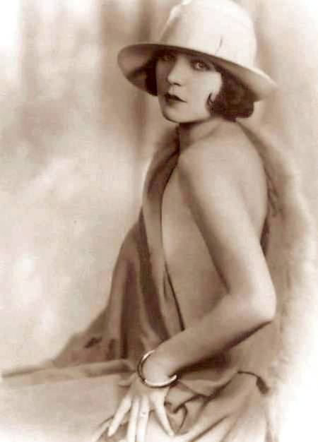 photo-movie-star-renee-adoree-three-quarters-with-hat-and-just-drapery-around-her-1920s1