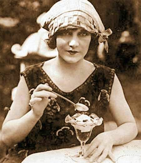 photo-movie-star-viola-sana-in-scarf-like-hat-eating-ice-cream-from-tulip-glass-1920s