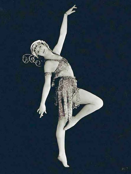 studio-portrait-movie-star-kathryn-mcguire-graceful-dance-pose-in-sparkling-costume-1920s