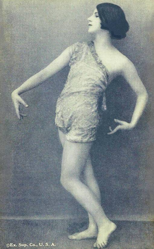 ARCADE CARD - EXHIBIT SUPPLY COMPANY - PIN-UP - WOMAN WITH BOBBED HAIR HEAD PROFILE IN SHEER OUTFIT IN DANCE POSE - 1920s