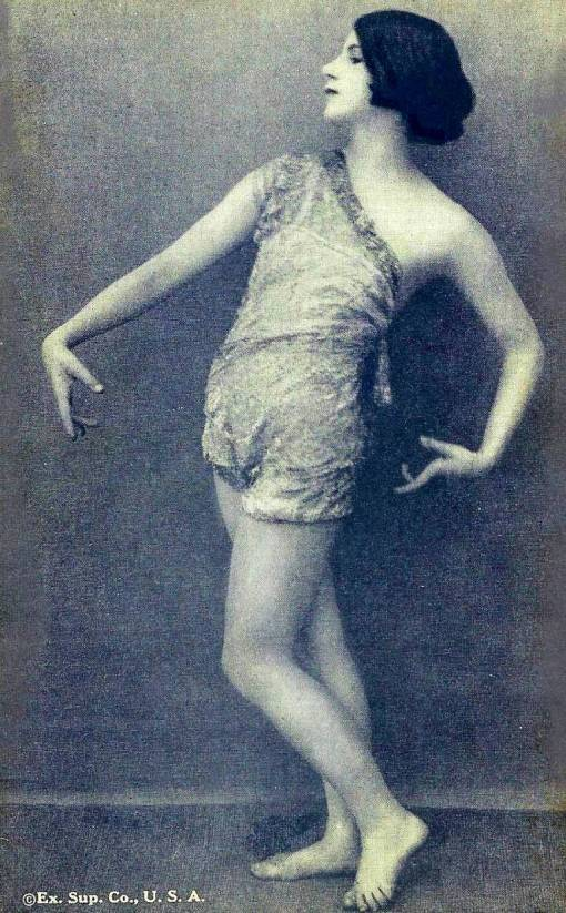 arcade-card-exhibit-supply-company-pin-up-woman-with-bobbed-hair-head-profile-in-sheer-outfit-in-dance-pose-1920s