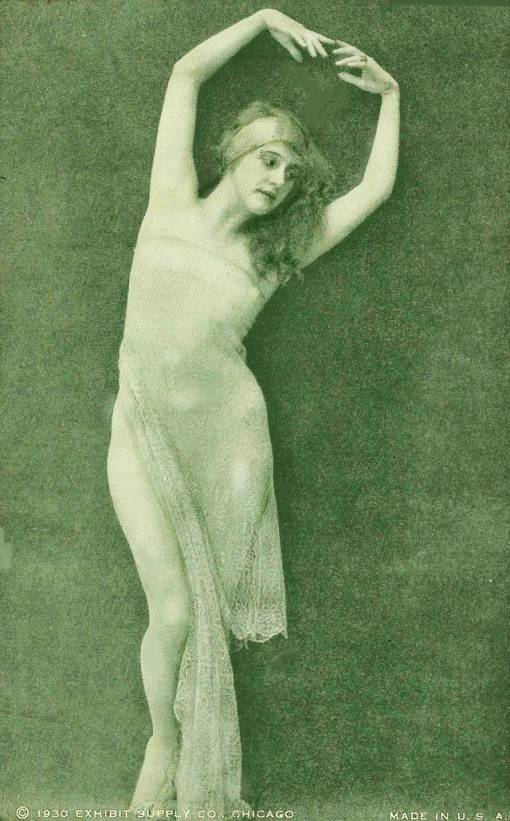 ARCADE CARD - EXHIBIT SUPPLY COMPANY - PIN-UP - WOMAN WITH HEADBAND AND LONG HAIR STANDING IN SHEER GARMENT WITH HANDS OVER HEAD - 1930