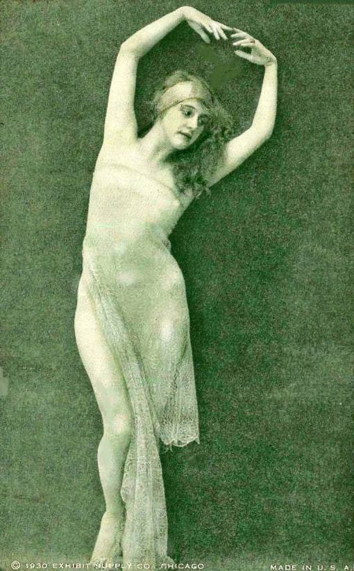 arcade-card-exhibit-supply-company-pin-up-woman-with-headband-and-long-hair-standing-in-sheer-garment-with-hands-over-head-1930