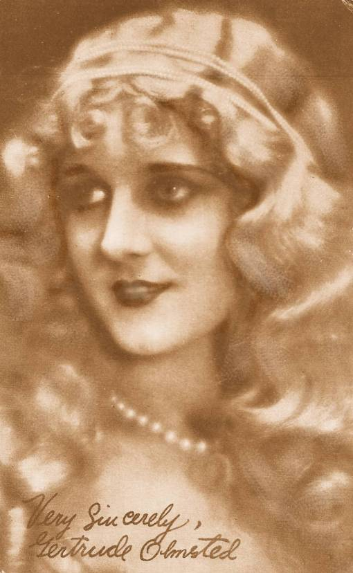 ARCADE CARD - MOVIE STAR - GERTRUDE OLMSTED - PEARL HEADBAND - LONG WAVY HAIR - THREE-QUARTERS VIEW