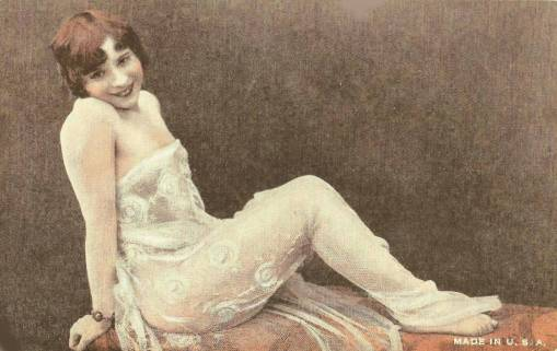 ARCADE CARD - UNKNOWN PUBLISHER - STYLE IS EXHIBIT SUPPLY COMPANY - PIN-UP - WOMAN WITH BOBBED HAIR IN LACE SITTING ON TABLE - TINTED - 1920s