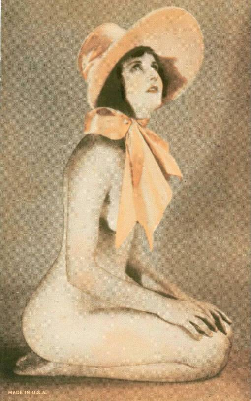 ARCADE CARD - UNKNOWN PUBLISHER - RESEMBLES EXHIBIT SUPPLY STYLE - PIN-UP - WOMAN SITTING ON KNESS WITH LARGE TIE BONNET  - 1920s
