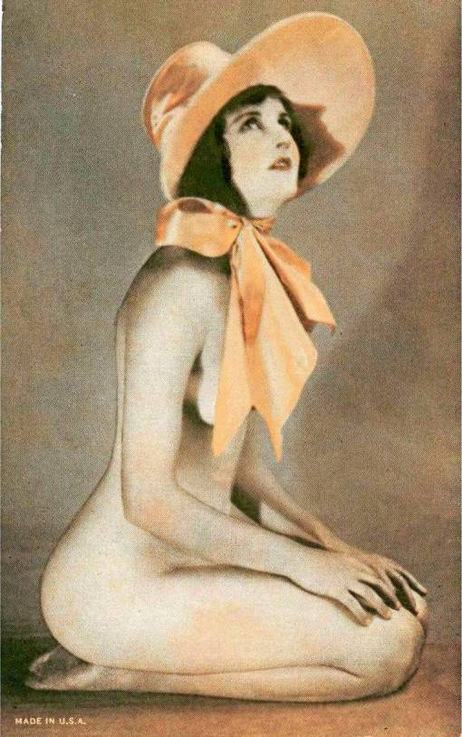 arcade-card-unknown-publisher-resembles-exhibit-supply-style-pin-up-woman-sitting-on-kness-with-large-tie-bonnet-1920s