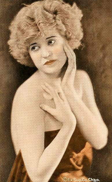 arcade-card-exhibit-supply-company-woman-with-bobbed-light-hair-and-hands-gracefully-around-face-1920s