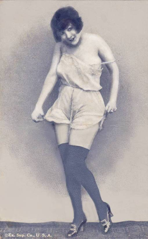 ARCADE CARD - EXHIBIT SUPPLY COMPANY - PIN-UP - WOMAN STANDING IN SHORT NIGHTIE WITH BOBBED HAIR AND HOLDING EDGES OF GARMENT - 1920s