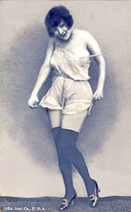 arcade-card-exhibit-supply-company-pin-up-woman-standing-in-short-nightie-with-bobbed-hair-and-holding-edges-of-garment-1920s1
