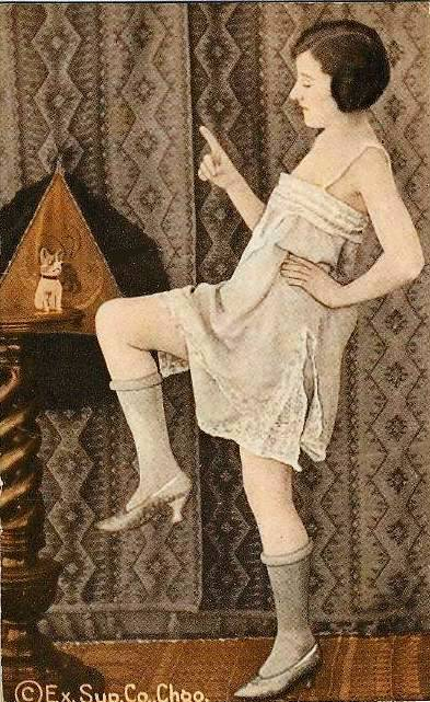 arcade-card-exhibit-supply-company-pin-up-woman-in-nightie-and-bobbed-hair-with-dance-pose-and-finger-waving-at-animal-doll-tinted-1920s