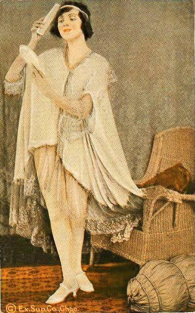 ARCADE CARD - EXHIBIT SUPPLY COMPANY - WOMAN IN HEADBAND AND NIGHTY STANDING COMBING HAIR - TINTED SERIES - 1920s