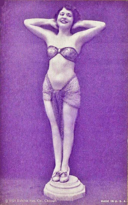 arcade-card-exhibit-supply-company-pin-up-woman-on-pedestal-with-arms-up-and-hands-behind-head-bobbed-hair-1929.jpg
