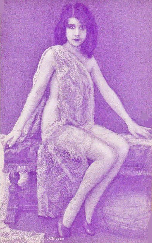 ARCADE CARD - EXHIBIT SUPPLY COMPANY - PIN-UP - WOMAN SITTING ON BENCH - WRAPPED IN LACE - LONG HAIR - 1929