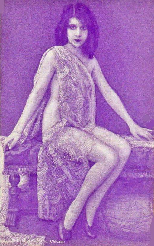 arcade-card-exhibit-supply-company-pin-up-woman-sitting-on-bench-wrapped-in-lace-long-hair-1929