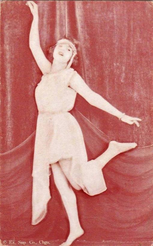 ARCADE CARD - EXHIBIT SUPPLY COMPANY - WOMAN WITH HEADBAND AND NIGHTIE IN DANCING POSE - 1920s
