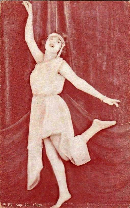arcade-card-exhibit-supply-company-woman-with-headband-and-nightie-in-dancing-pose-1920s