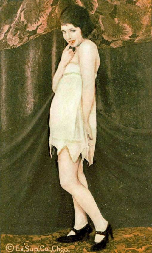a-arcade-card-exhibit-supply-company-pin-up-woman-in-bobbed-hair-standing-in-nightie-with-finger-on-lips-1920s1