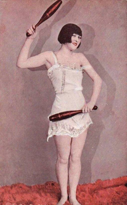 a-arcade-card-exhibit-supply-company-pin-up-woman-with-bobbed-hair-and-nightie-holding-indian-clubs-1920s