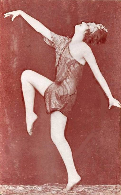 ARCADE CARD - EXHIBIT SUPPLY COMPANY - WOMAN IN SILKY WRAP WITH BOBBED HAIR AND HEAD ORNAMENT PROFILE DANCING POSE - 1920s