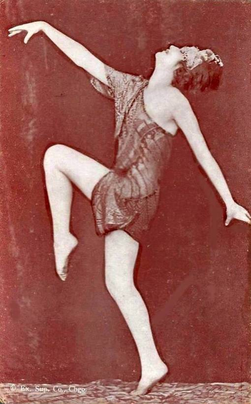 arcade-card-exhibit-supply-company-woman-in-silky-wrap-with-bobbed-hair-and-head-ornament-profile-dancing-pose-1920s