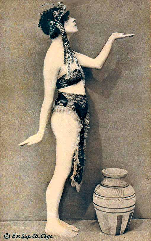 a-arcade-card-exhibit-supply-company-pin-up-woman-standing-profile-in-egyptian-like-pose-and-head-dress-1920s1