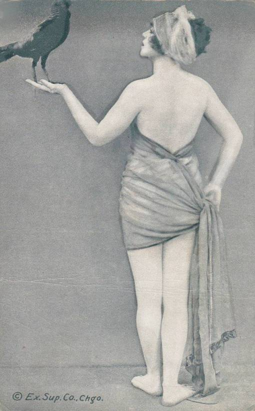 arc ARCADE CARD - EXHIBIT SUPPLY COMPANY - PIN-UP - WOMAN STANDING BACK TO CAMERA WITH HEAD PROFILE HOLDING BIRD AND END OF GARMENT - 1920s