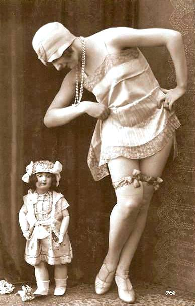arc-arcade-card-french-woman-in-cloche-hat-standing-next-to-boudoir-doll-with-slip-hiked-1920s