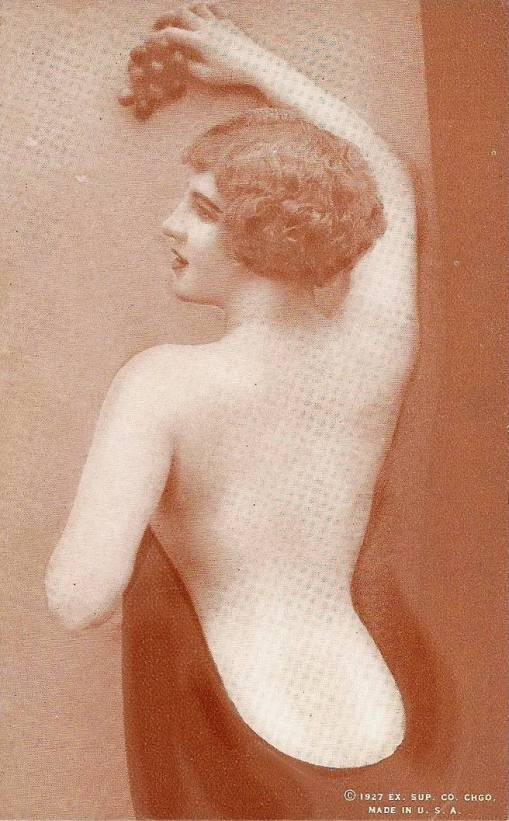 arc ARCADE CARD - EXHIBIT SUPPLY COMPANY - PIN-UP - WOMAN WITH BOBBED HAIR BACK TO CAMERA HOLDING GRAPES - 1927